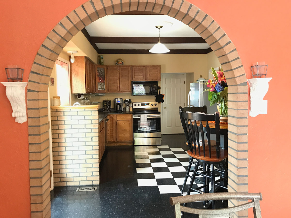 View of kitchen in Lakeview Rental Home. Brick work and bright walls accent this lovely kitchen area