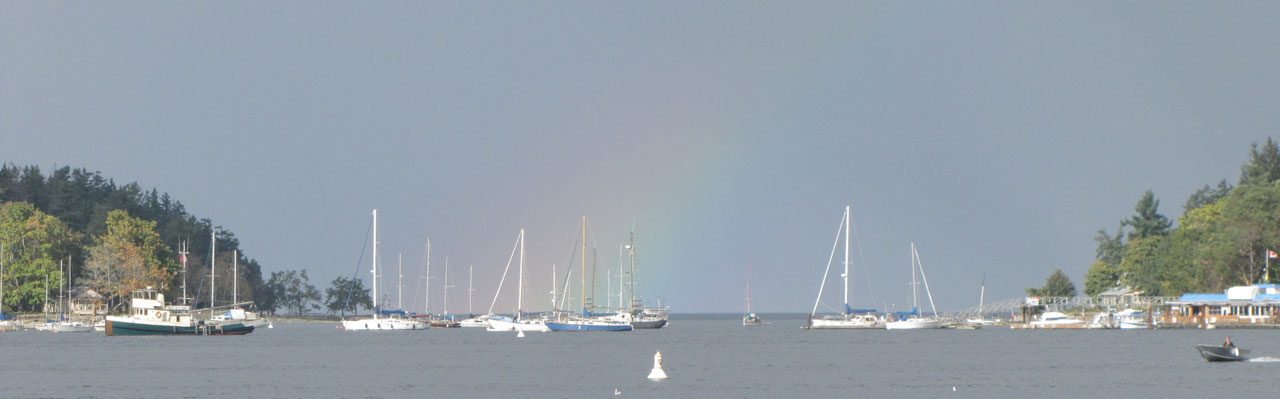 Rainbow over the ocean boats at parks of Nanaimo