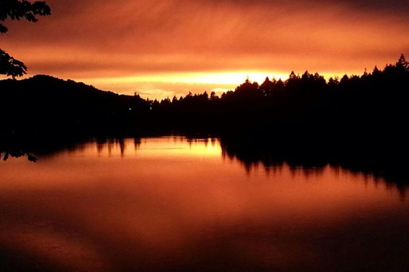 Beautiful orange sunset reflecting on Nanaimo Lake