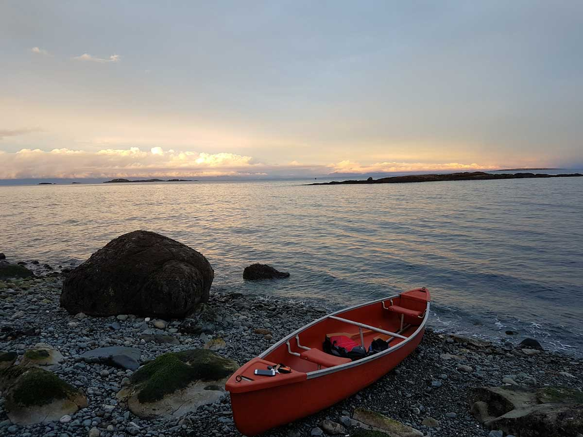 Red canoe on Vancouver Island beach