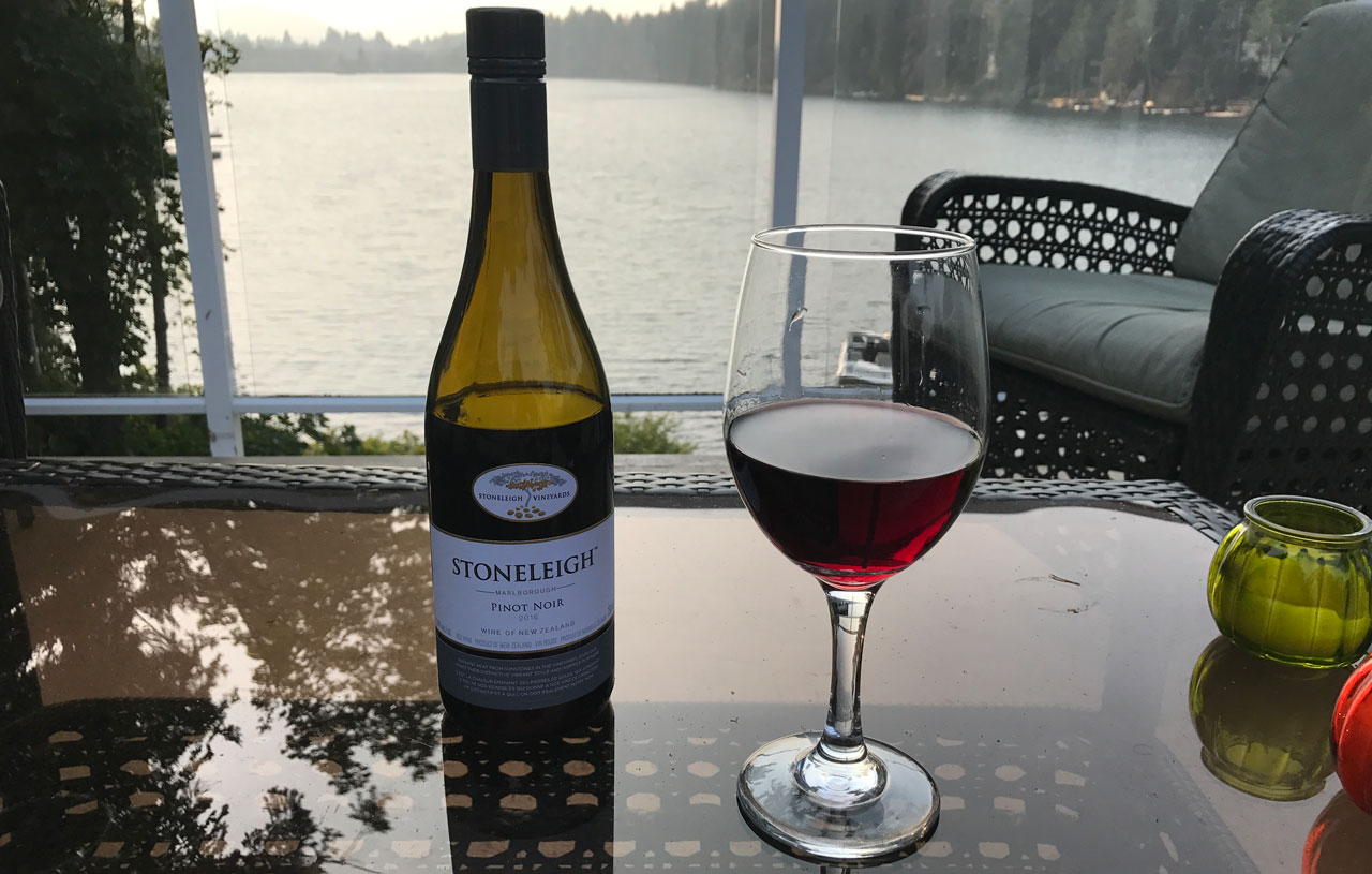Bottle of wine and wine glass from Vancouver Island Wineries