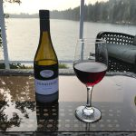Stoneleigh bottle of wine and wine glass on table overlooking lake Nanaimo, BC