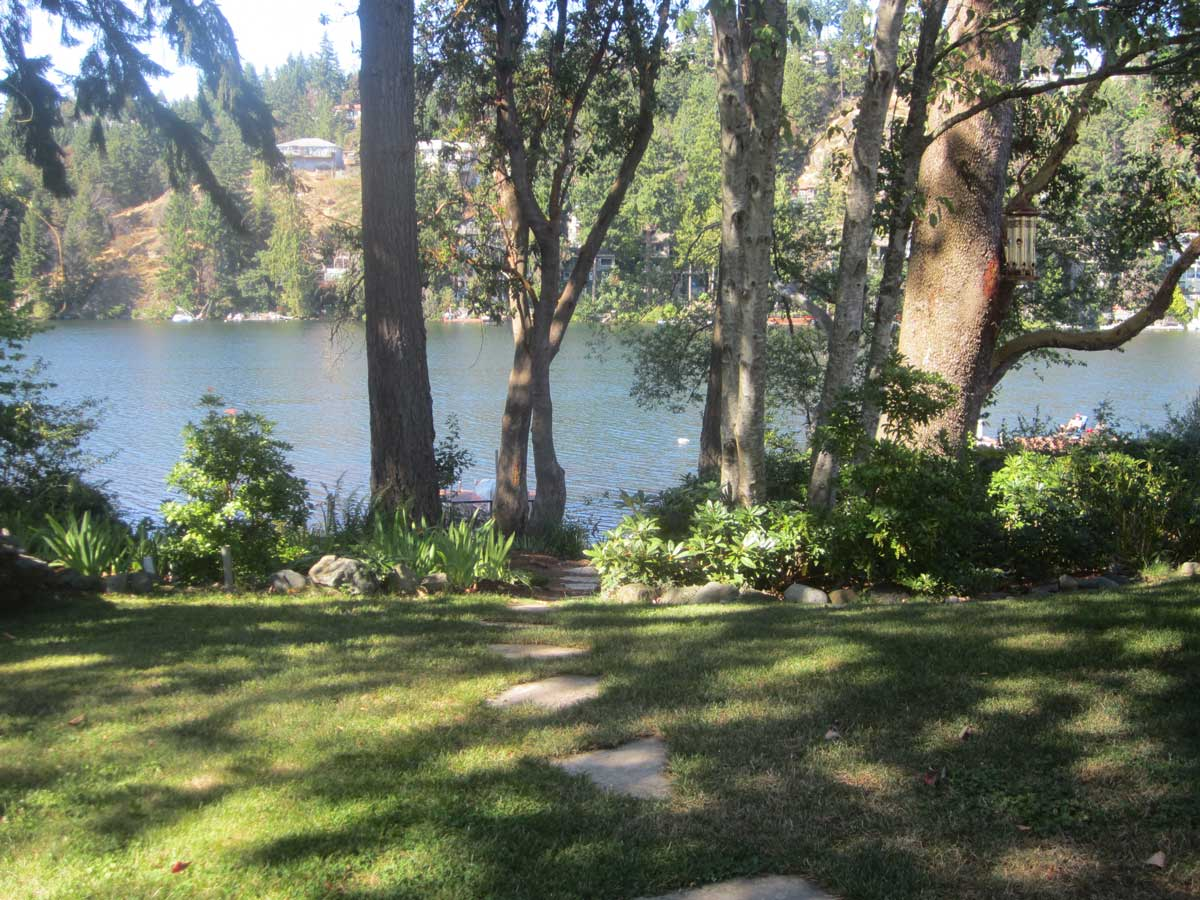 Executive Lakeview rental home yard that has been beautifully landscaped