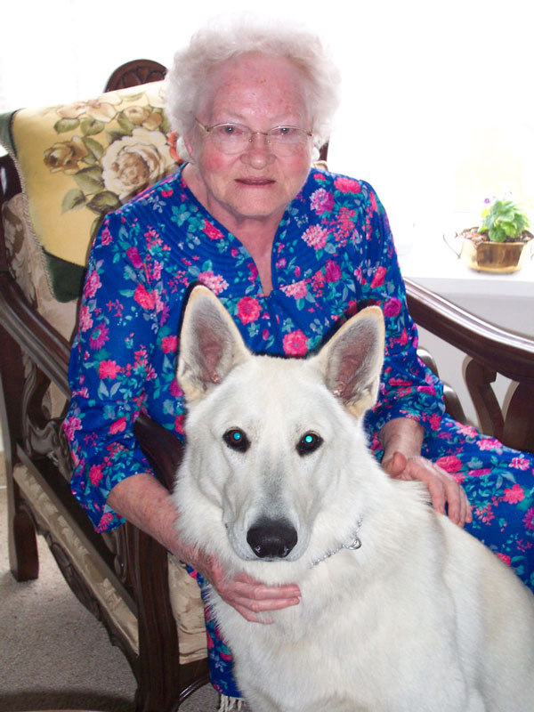 Senior citizen with white dog