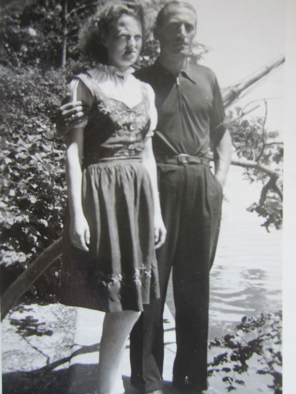 Old black and white photo of a man and wife