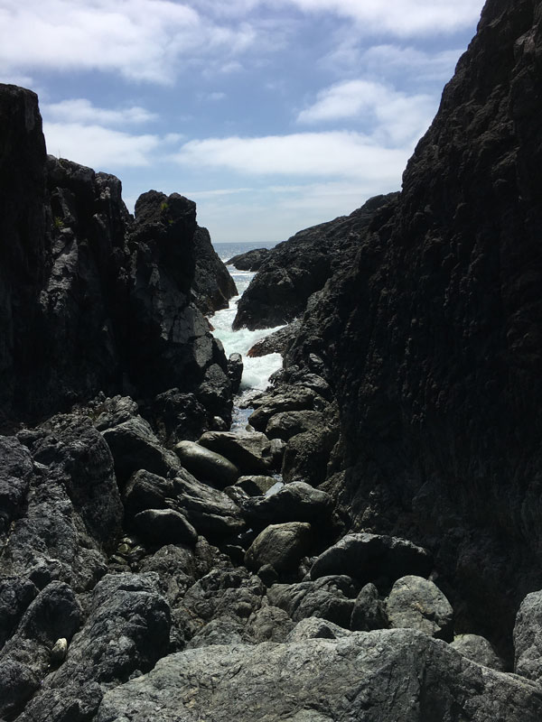 Rocky terrain with ocean at a distance